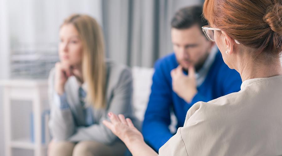 Divorcing couple attending mediation session